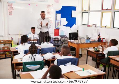 Teacher taking a lesson of elementary school kids #667978957