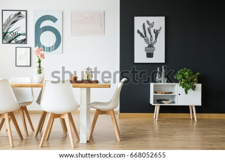 Black and white wall in dining room with plants #668052655