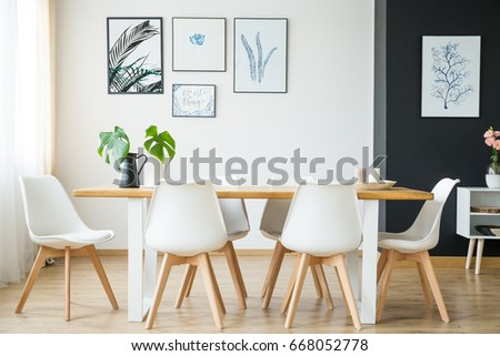 Bright spacious dining room with wooden big table Royalty-Free Stock Photo #668052778