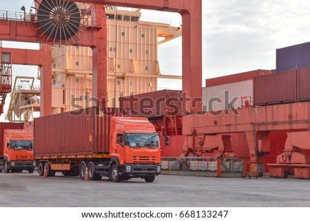 Seaport operation, container discharging from vessel. Truck picking up container from vessel. #668133247