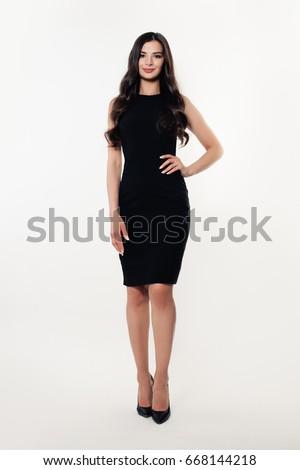 Fashion Portrait of Beautiful Model Girl wearing Black Dress #668144218