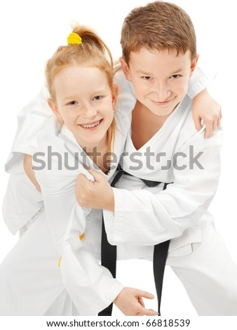 Smiling karate boy and girl, isolated on white #66818539