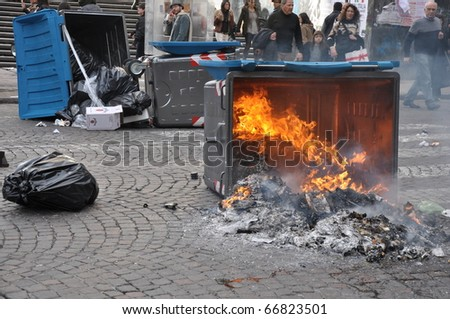 NAPLES, ITALY - DECEMBER 8: fire and violence during a strike in the city of Naples, Italy on December 8, 2010. the demonstration involved students against the Italian government #66823501