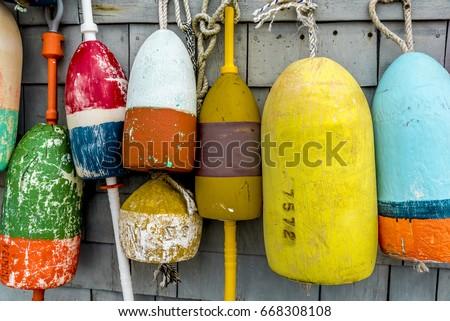 Lobster Buoys on Barn Wall Royalty-Free Stock Photo #668308108