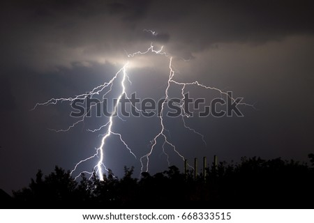 lightnings and thunder bold stike at summer storm