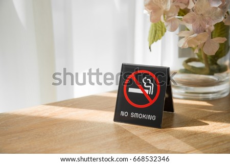 No smoking sign in hotel room with sunlight