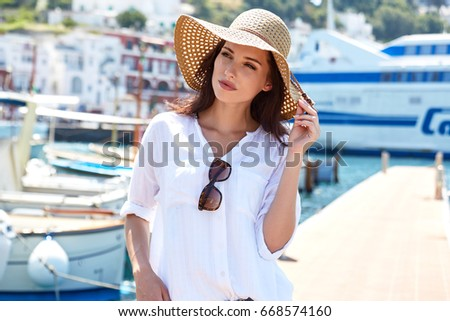 Beautiful young woman on vacation. Summer concept.  #668574160