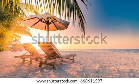 Summer holiday and vacation design. Inspirational tropical beach, palm trees and white sand. Tranquil scenery moody travel landscape #668611597