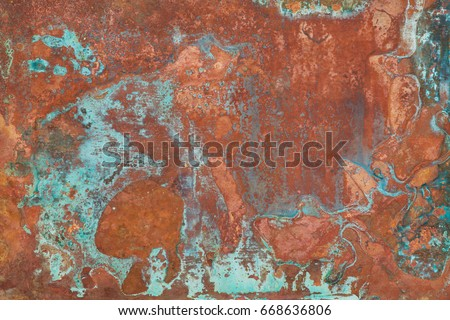 Aged copper plate texture with green patina stains. Old worn metal background. #668636806