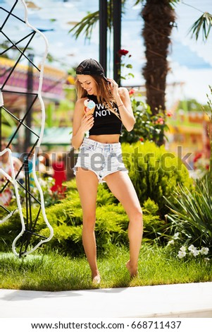 Pretty girl with ice cream on summer vacation #668711437