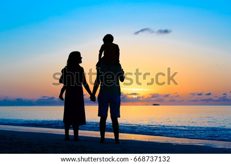 happy family with two kids walking at sunset #668737132