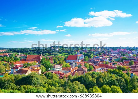 Panorama of Vilnius cityscape and old churches, Lithuania, Baltic country. #668935804