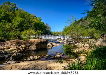 The western point of Eno River State Park in Durham, North Carolina. This is one of the best parks in the city just few miles from Duke University, with lots of hiking trails below the thick forest. #668965963