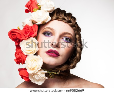 Gorgeous Woman with flowers arround her head in studio photo. Beauty and fashion. Glamour and summer #669082669