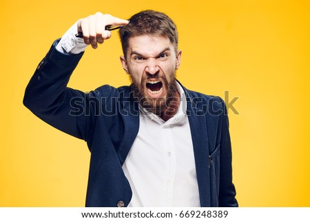 Businessman with a beard on a yellow background, emotions, portrait, boss, anger, scream, aggression. Royalty-Free Stock Photo #669248389