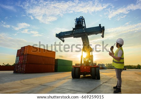 foreman working in container yars checking and report online by protable device #669259015