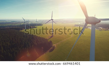 Wind turbines and agricultural fields on a summer day - Energy Production with clean and Renewable Energy - aerial shot, analog image style #669461401