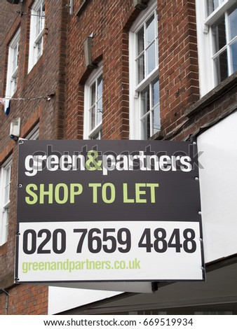 Newbury, Northbrook Street, Berkshire, England - June 16, 2017: Estate Agent Green and Partners shop to let sign over vacant retail property #669519934