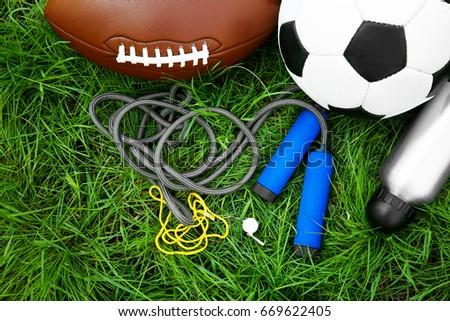 Group of sport equipment on green grass #669622405
