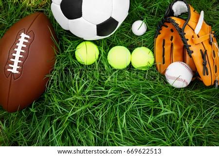 Group of sport equipment on green grass #669622513