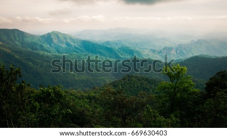 beautiful landscape nature of rain forest and mountain background. abundance evergreen forest in spring. nice place for outdoor travel on vacation or holidays. tropical forest of thailand. #669630403