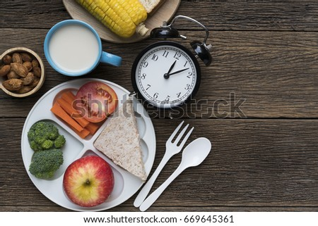 Meal time with alarm clock at lunch time #669645361