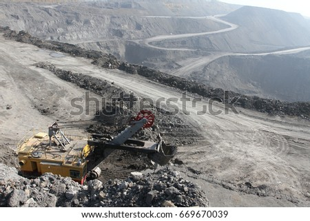 The excavator in the quarry. The view from the top. Mining. Coal mining #669670039