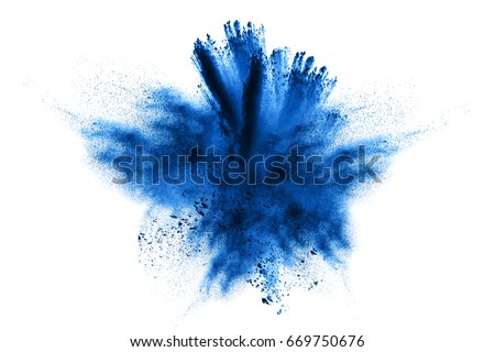 Abstract blue powder explosion on white background. Closeup of  blue dust particles splash isolated on  clear background. Royalty-Free Stock Photo #669750676