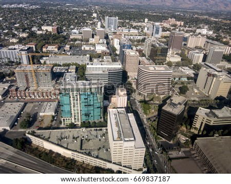 An aerial view of downtown San Jose looking down Santa Clara street towards the East foothills.