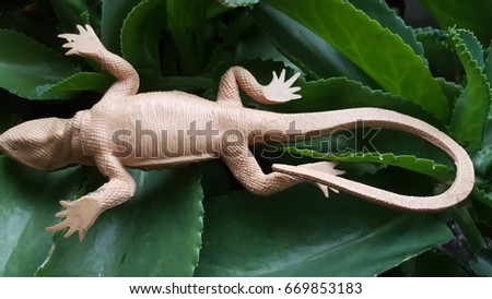 Toy Abdominal Side of Iguana Lizard like Reptile in Plastic Material for Outdoor, Halloween, Party, Decoration, on White background #669853183