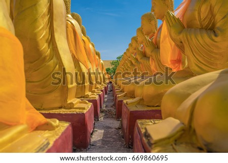 Buddha image with 1250 disciples statue with nice sky, Nakhonnayok. #669860695