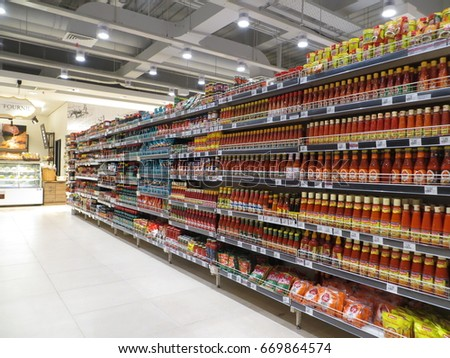 SERPONG, INDONESIA - June 3, 2017: Various flavoring products on the shelves in a supermarket. #669864574