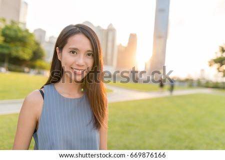 Business woman in Hong Kong under sunset #669876166