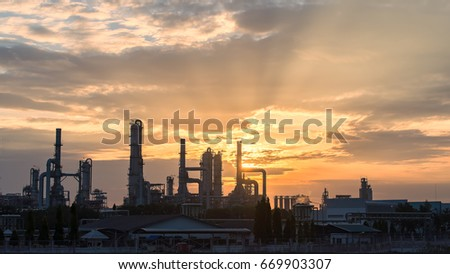 Gas turbine electrical power plant at dusk with orange sky,industrial #669903307