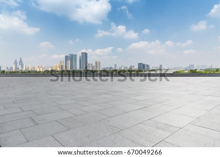 Panoramic skyline and buildings with empty concrete square floor  #670049266