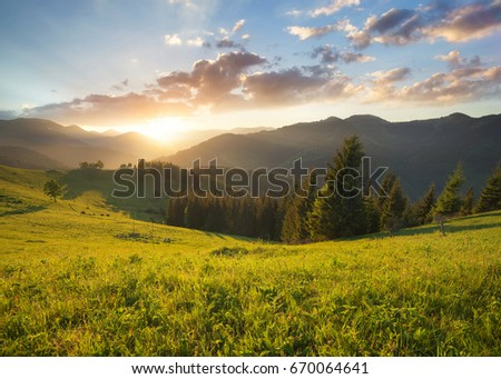 Sunset in the mountain valley. Beautiful natural landscape in the summer time #670064641