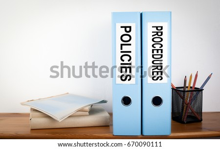 Policies and Procedures binders in the office. Stationery on a wooden shelf Royalty-Free Stock Photo #670090111