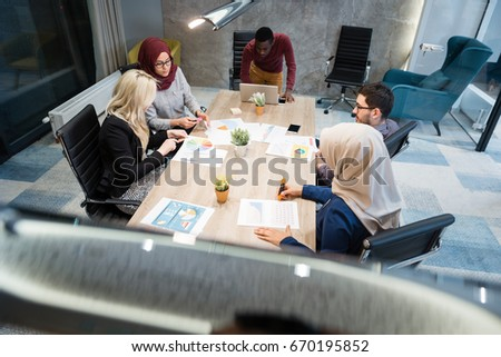 Multi-Cultural Office Staff Sitting Having Meeting Together #670195852