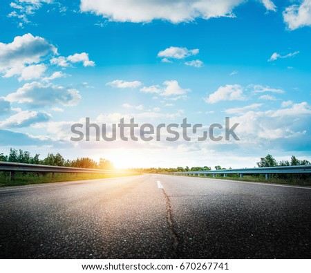 Road way forward direction. Summer morning landscape #670267741