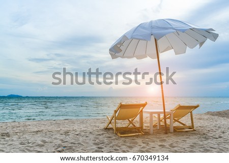Double Beach chair on sand seascape and bright sky in summer vacation relax #670349134