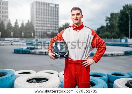 Kart driver with helmet in hands, Go-kart #670361785
