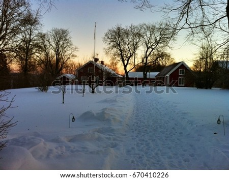 SWEDEN, EUROPE - NOVEMBER 25, 2013 -  Panorama of Sweden in winter, with typical wooden houses #670410226