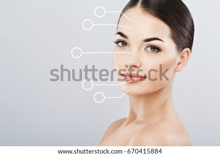 Portrait of young female with clean fresh skin, antiaging concept. Attractive woman with naked shoulders, looking at camera and smiling, graphic circles showing areas of lifting #670415884