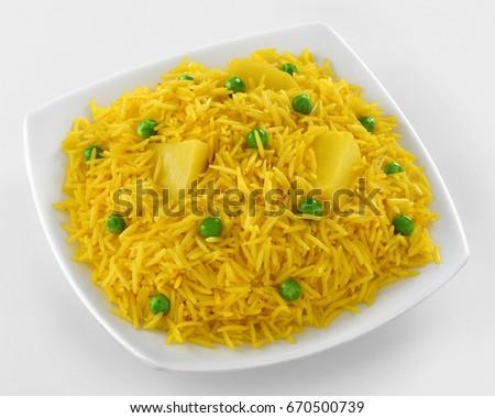 Aloo ki Tahari (Delicious Indian Rice, with potato and green peas) #670500739