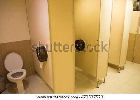 Public toilet room empty. #670537573
