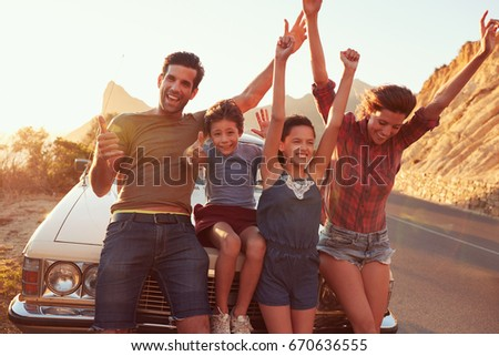 Portrait Of Family Standing Next To Classic Car #670636555