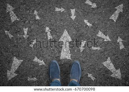 man standing on road with many direction arrow choices or move forward. concept solution and start. #670700098
