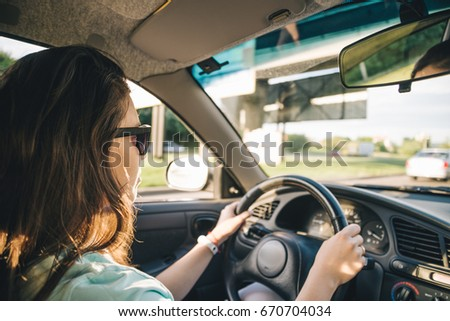 young woman driving car view inside, summer day #670704034