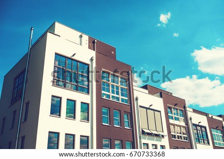 expensive and modern townhouses with beautiful sky #670733368