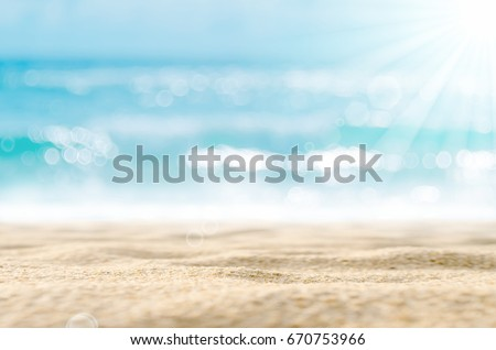 Blur tropical beach with bokeh sun light wave abstract background. Copy space of outdoor summer vacation and travel adventure concept. Vintage tone filter effect color style. #670753966